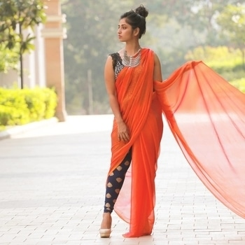 .. it's kinda fun sometimes to add a twist to the traditional methods like drape your shifon or a marble crepe saree on a lacy top and a printed jegging. It gives the whole look a stylish edge. Top it on with right amount of attitude and your ready to RULE.....