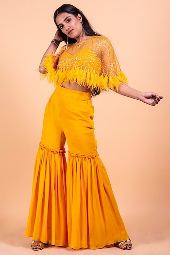 In yellow, the hottest color of the season! Featuring gharara #pants by Coutshae, paired with a bustier & embroidered #cape: https://www.indiancultr.com/new-arrivals/the-dance-of-flowers-by-coutshae?trk=row-4 #luxury #makeinindia #artisans #fashion #style #fashionpost #India #incredibleindia #shoponline #new #love #beautiful #wow #amazing #label #designer #want #neednow #instalike #newarrivals #photooftheday #indiancultrexclusive #exclusive