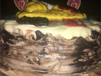 #Anniversary #cake from my son's point of view.  It has #layers of #egglessmarblecake and #egglessbrownies filled with #chocolateganache. The icing is #buttercream cheese and #fondant #cake-lover #cakelover #cakedecorating #cakedesigns