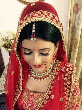 Bride in a very elegant bridal makeup. Makeup and hair by Richa Malik's Makeovers. #makeup #indianbridalmakeup #bridalmakeupartist #bridalmakeupartist #asianbridalmakeup #weddingmakeup #makeupartistgurgaon #bridallook #makeupaddict #mua #muadelhi #wedmegood #weddingplz