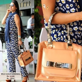 Our blogger definitely knows how to add edge to her style by adorning our classy wild gold handbag
