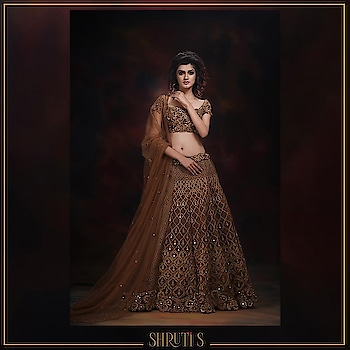 An antique-gold, half n half embroidered lehenga. The lehenga has an exclusive dori work mixed up with mirrors, sequins and zari.  #shrutis #shrutisingla #indiancouture #lehenga #bridallehenga #fashiondesigner #lehengacholi #embroidery #beautiful #engagementdress #wedding #indianwedding #bride #weddingdress #antiquegold #punjabiwedding #ootd #picoftheday #brideoftheday #alamaara