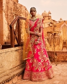 AMEERA  The power of giving a vital support for continuance of life. Ameera is a beautiful amalgamation of contrasting colours to mould a delightful lehenga for the bride to be. Delicate zardoz and gota patti embroidery, inspired from the art and architecture of Rajasthan is perfect for one of the most special days.  #suemue #bespoke #bridal #suemuebridal #banithani #aw16 #bride #bridetobe #heritage #tradition #handcrafted #handloom #wedding #indianwedding #traditionalindianwear #ameera #magenta #gotapatti #zardoz #flower #garland #fashion #fashionblogger #weddingblogger #lehenga #trousseau #specialday #ootd #outfitoftheday