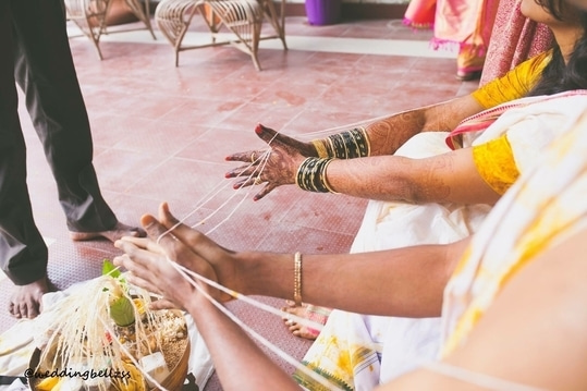 Pre wedding ceremonial ritual of haldi. Not only are the colours beautiful but also make the day brighter and beautiful . @call us to cover ur wedding day #candidphotography  #bangaloreweddingphotography