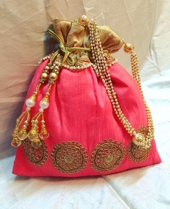 The Fancy traditional ethnic Pearl Beaded Potli Bags to carry with the Indian Attire.Can be customised in any colour of your choice.