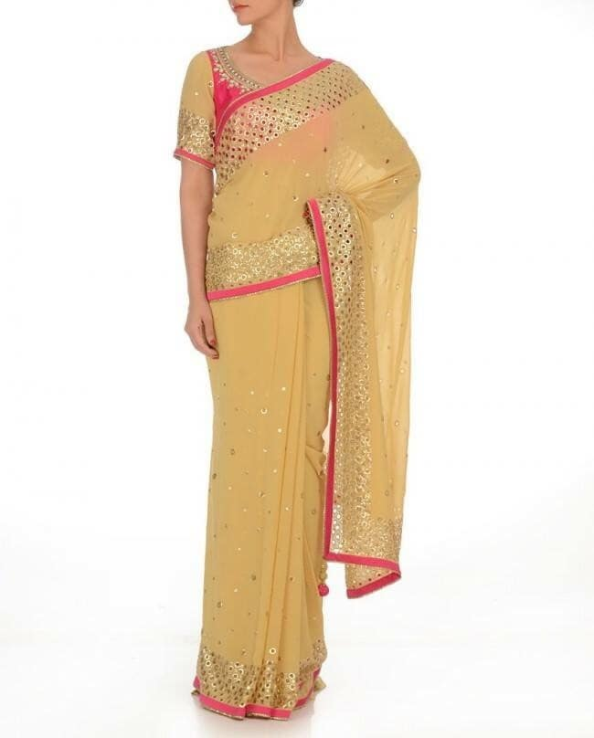 All That #Glitters: net #saree adorned with cutwork #patterns. #Shop here: http://www.indiancultr.com/clothing/sarees.html?limit=48 #sarees