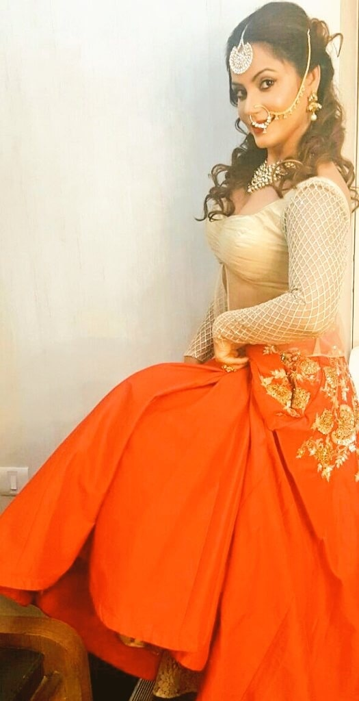 Neetu Chandra in a saffron and gold lehenga set #libasreshmariyaz #libasriyazgangji #gangjijewels #saffron saffronandgold #traditionalwear #nosering #maantikka #trousseau #ethnic-wear #indianbride #indiancouture  #celebrityfashion