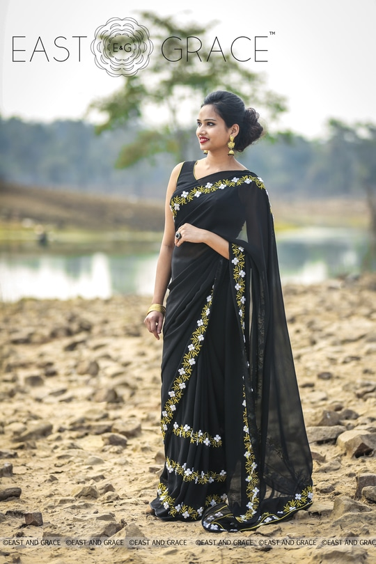 PRICE: INR 7,956.00; US$ 120.55 **************************************** Please visit this link to purchase the saree: https://www.eastandgrace.com/products/black-buttercup Featuring the Black Buttercup saree in pitch black, 100% pure silk georgette with white ribbonwork buttercup flowers and golden thread embroidery leaves, that is perfect for evening affairs. The accompanying black blouse has a golden edging for an alluring finish. Brimming with vintage-inspired glamour, this saree is your staple of sorts. Subscribe to our newsletter on our website to get latest updates on EAST & GRACE sarees. For order related inquiries, please reach out to us at orders@eastandgrace.com. For all other questions/comments/concerns or just some cool banter, get in touch at care@eastandgrace.com and someone will be available to assist you! We are humbled by the tremendous response from different parts of the world. It's what keeps us going! More beautiful designs coming soon your way… :) With love, EAST & GRACE www.eastandgrace.com #eastandgrace #saree #happyshopping #beautiful #indian #sari #desi #lehenga #indowestern #love #indianwedding #onlineshopping #indianfashion #satin #chiffon #whiteribbon #ribbon #black #nature #fashion #fashionista #stylefile #trendy #Beautyvblogger #diy #delhifashion
