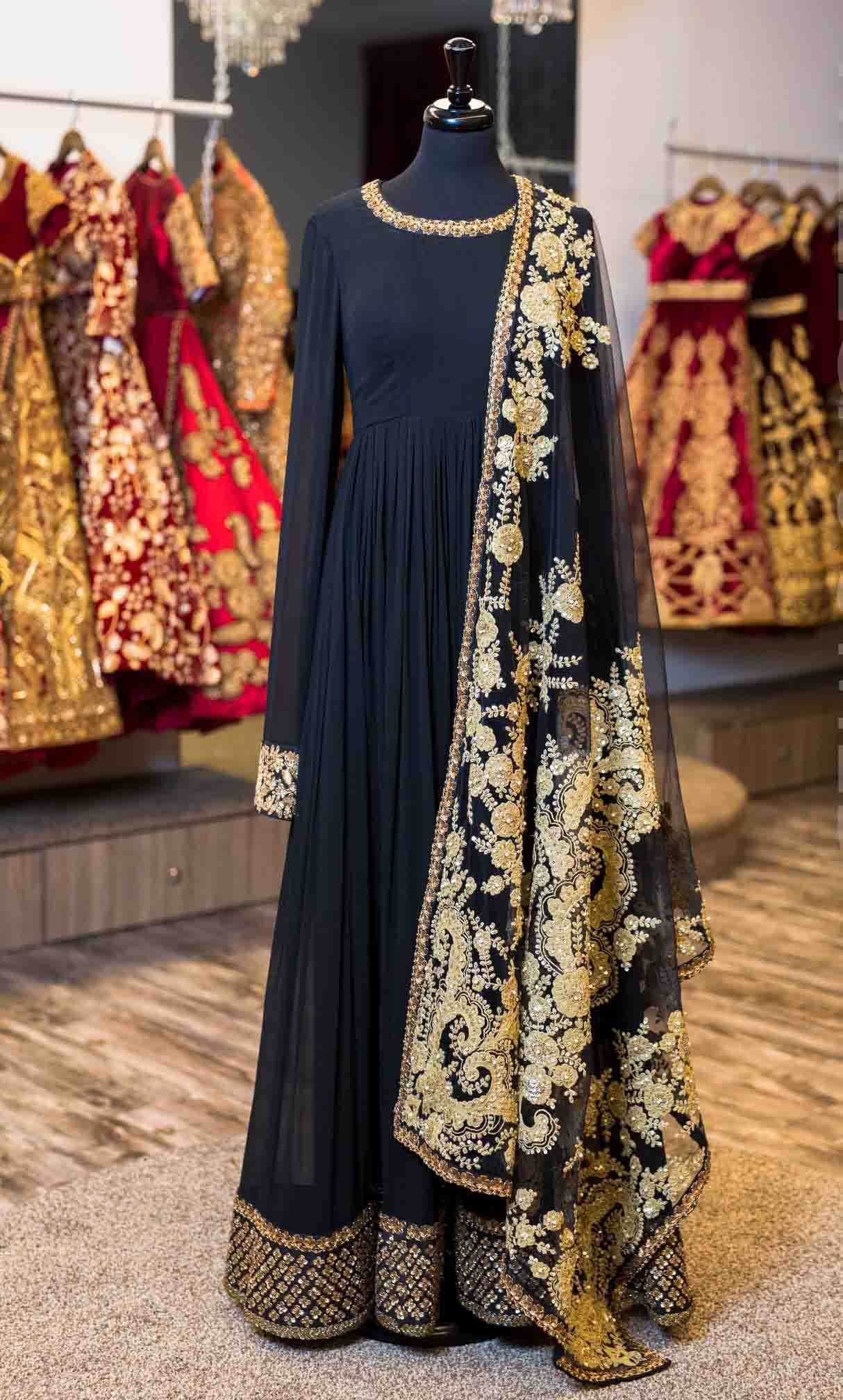Black georgette floor length anarkali  With cuff, neckline, and border embroidery  Paired with black net dupatta, which is fully embroidered