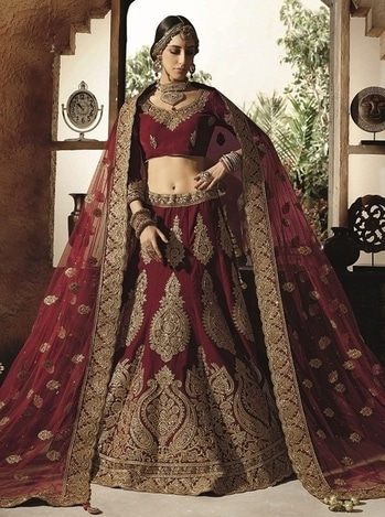 MAROON HEAVY EMBROIDERED BRIDAL WEAR INDIAN VELVET GHAGRA CHOLI For more information about this designer bridal wear lehenga, click the below link https://www.gravity-fashion.com/maroon-heavy-embroidered-bridal-wear-indian-velvet-ghagra-choli-c17144.html