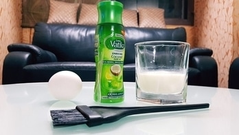Home Remedy for frizzy hair -  Ingredients : - 1 egg - Coconut Oil - Milk - Hair Brush  Method :  1. In a bowl,  take one egg or two depending on the thickness and length of your hair. Add few drops of lemon juice if you find smell of egg is unpleasant. 2. Mix 3-4 tbs of milk and few drops of Coconut Oil.  3. Beat all the ingredients until frothy.  4. Cover it with a shower cap and leave it for about 20 minutes. 5. Rinse well with cold water and a mild shampoo.  Results : Apply the hair mask twice a week to have soft, frizzy-free hair.  #haircare#haircaretips#frizzyhair#Remedies