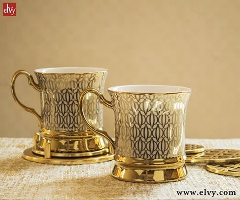 Make a simple tea session a luxurious affair with our Wisteria mug with gold handle and gold abstract repeat pattern which is easily a show stealer. Made in fine porcelain with gold rim, the piece gives a contemporary feel. Now available online. #SHOPNOW at www.elvy.com #homedecor #stylishlook #luxuryhome #elvycollections #kitchenware