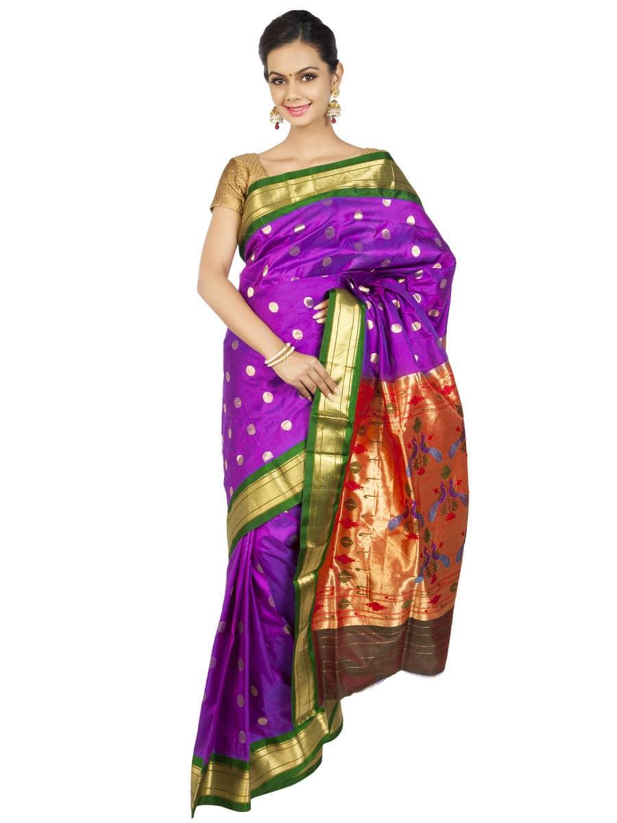 Violet paithani with green borders. Price : ₹13,800.00 or $230.00 Click to shop now https://goo.gl/9BpEHI  #ethnicsaree #designersaree #paithani #onlypaithani