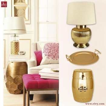 Style up your interiors with these gold coloured products and add a touch of glamour to your refreshing and colourful ambience. MRP for Lamp with Shade - ₹24,995 MRP for Round Metal Tray - ₹1,495 MRP for Gold Stool - ₹14,995 #SHOPNOW at www.elvy.com