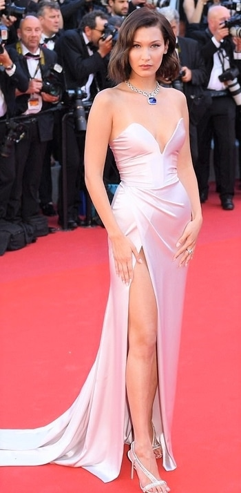 Bella Hadid attended the opening gala of Cannes Film Festival in a custom made couture creation by Alexandre Vauthier, which featured a strapless sweetheart neckline, a side split and a dramatic train. We love the champagne shade and slinky silk fabric of this frock. When teamed with a dazzling sapphire necklace by Bulgari, it's old school Hollywood glamour at its finest.  #cannesfilmfestival2017 #cannes #redcarpet #bellahadid #alexandrevauthier #hollywood #international #internationalfashion #highslit #sexylegs #goals #sultry #hollywoodglamour #internationalmodel