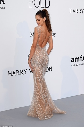 Brazilian model Izabel Goulart donned a sheer fishtail custom Zuhair Murad gown with intricate sequin beading across the bodice and down her figure-flaunting skirt. #cannes2017 #cannes #cannesfilmfestival #internationalfashion #sheer #gown