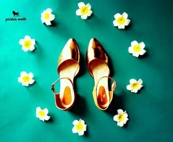Slip your feet into these copper sandals from Pride's Walk and revel in the unique style of this pair.These sandals are absolutely comfortable And could be teamed with midi-dress and a box clutch to complete your stylish look. Shop now from www.prideswalk.com or visit our retail store!  #prideswalk #metallicshoes #metallicsandals #metallics #womenfashion #menfashion — at Canopus - Shopping MALL.