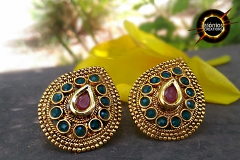 Polki Studs – Chetana is handcrafted from brass metal alloy. These studs has red kundan studded at center which is surrounded by green stones. These studs are pear shaped and has back stopper. Polki is a Rajasthani style of jewelry. This made its way into India by Mughals. ORDER THEM NOW !! FREE CASH ON DELIVERY !! #aionios#aioniosceations#bridal jewellery#choker#Choker #classy#coin jewelry#designed#designer #diamond necklace#fashion jewelry#handcrafted #handmade jewelry #JEWELLERY#Jewelry#jewelry making#lakshmi#lakshmiset #necklace designs#Necklace Set #ootd#ott #Polkiset#temple jewellery#temple jewelry#set #trendy#trendalert#lookoftheday#picoftheday#fashionblogger