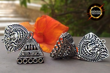 This beautiful Jhumka Design is handcrafted from antique silver metal alloy. This Jhumka Design has lakshmi stud and intricately crafted silver pyramid jhumka. We have beautiful lakshmiji crafted on it. Lakshmiji is the goddess of prosperity and wealth. May her blessings be always with us. This jhumka Design is perfect for the chic in you. This design is perfect for a casual outing with your friends and family. Grab it before someone else does! FREE CASH ON DELIVERY !! #aionios#aioniosceations#bridal jewellery#choker#Choker #classy#coin jewelry, #designed, #designer, #diamond necklace#fashion jewelry, #handcrafted, #handmade, #india, #indian jewelry #JEWELLERY#Jewelry#jewelry making, #lakshmi#lakshmiset #necklace designs#Necklace Set #ootd#ott #Polkiset#temple jewellery#temple jewelry#set #trendy#trendalert#lookoftheday#picoftheday#fashionblogger