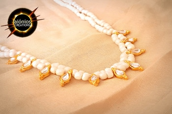 A Long Necklace from a golden kundan beads  at center coupled with beautiful tiny string of white  seed beads. Wear this with simple saree or kurti and look glamorous.  ORDER THIS NOW !! FREE CASH ON DELIVERY !! #aionios#aioniosceations#bridal jewellery#choker#Choker#classy#coin jewelry#designed#designer#diamond necklace#fashionjewelry#handcrafted#handmade#india#indian jewelry#JEWELLERY#Jewelry#jewelrymaking#lakshmi#lakshmiset #necklacedesigns#NecklaceSet #ootd#ott#Polkiset#temple jewellery#temple jewelry#set #trendy#trendalert#lookoftheday#picoftheday#fashionblogger#ordernow#booknow#shopnow#knowmore#roposolove#soroposo#picoftheday#lookoftheday