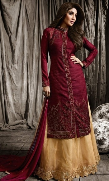Maroon and Beige Stone Stud Designer Salwar Frock Suit  • Stone Stud Designer Salwar Frock Suit • Fabric : Raw Silk • Bottom Fabric : Net • Dupatta Fabric : Chiffon • Size : Semi-Stitched (customizable Upto size-44)  SKU: SUEBRKR1586 Rs. 6,499.00