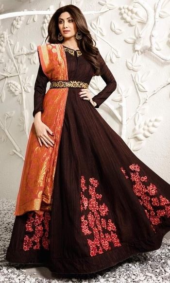 Brown Stone Stud Designer Salwar Frock Suit  • Stone Stud Designer Salwar Frock Suit • Fabric : Raw Silk • Bottom Fabric : Silk • Dupatta Fabric : Jacquard • Size : Semi-Stitched (customizable Upto size-44)  SKU: SUEBRKR1581 Rs. 6,499.00