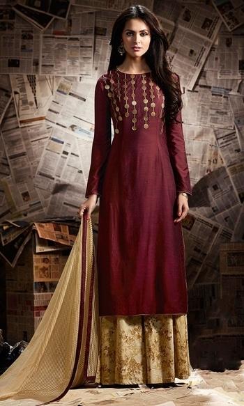 Party Wear Maroon Designer Salwar Suit  • Party wear Frock Suit • Fabric : Cotton Satin • Bottom Fabric : Cotton • Dupatta Fabric : Jacquard Net • Size : Semi-Stitched (customizable Upto size-44)  SKU: SUEMUG1135 Rs. 2,199.00