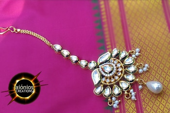 This is a attractive jewelry piece handcrafted in brass metal alloy and has gold plating. Kundans are studded in chand of mang tika and has cubic zircon stones studded at the center of it. This beautiful adorn also has fresh water pearls attached at the bottom of it. This will surely going to grab the attention of people so ORDER THEM AND MAKE THEM YOURS !! FREE CASH ON DELIVERY ! #mangtikalove#mangtika#goldensilve #aionios#aioniosceations#bridal jewellery#choker#Choker #classy#coin jewelry, #designed, #designer, #diamond necklace#fashion jewelry, #handcrafted, #handmade, #india, #indian jewelry #JEWELLERY#Jewelry#jewelry making, #lakshmi#lakshmiset #necklace designs#Necklace Set #ootd#ott #Polkiset#temple jewellery#temple jewelry#set #trendy#trendalert#lookoftheday#picoftheday#fashionblogger#ordernow#shopnow#booknow