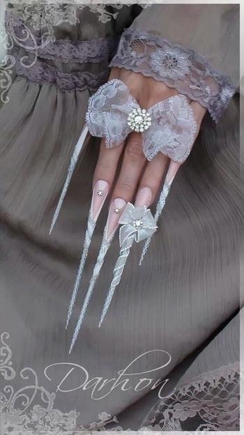 #nailswithrhinestones #nail-designs #nail colour and art #doublecoloured #stelittonails #stilettosstyle #ribbonjewerllery #lacenet