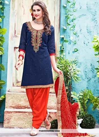 RESPLENDENT BEADS WORK CHANDERI SILK PATIALA SALWAR KAMEEZ Genuine attractiveness comes out from your dressing #style with this #navyblue and #tomato #chanderisilk #patiala #salwarkameez. The enticing #beads, #goldzardosi, #karachi, lace and #resham work throughout the dress is awe inspiring. Comes with matching bottom and dupatta. Product Code: 40514 INR Rs5,115 SHop Now @ https://www.fashionwebz.com/punjabi-suits/resplendent-beads-work-chanderi-silk-patiala-salwar-kameez_40514 #punjabisuit #patialastylesuit #indianfashion #ethnic-wear #indianethnics #fashionwears #latestcollection #shopping #womenwear