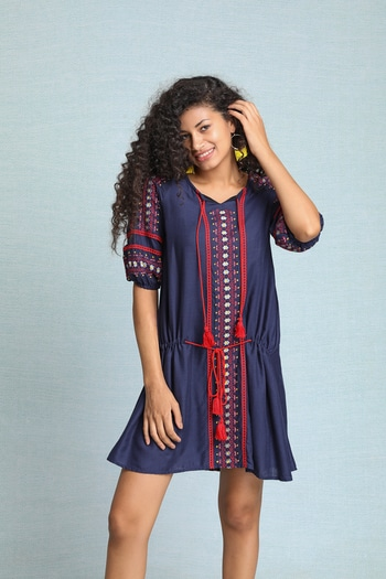 Stay comfortable  all day long with in this minimalist mini blue dress with attractive colour blocked embroidery and tassels... #bohofashion #boholife #fashion