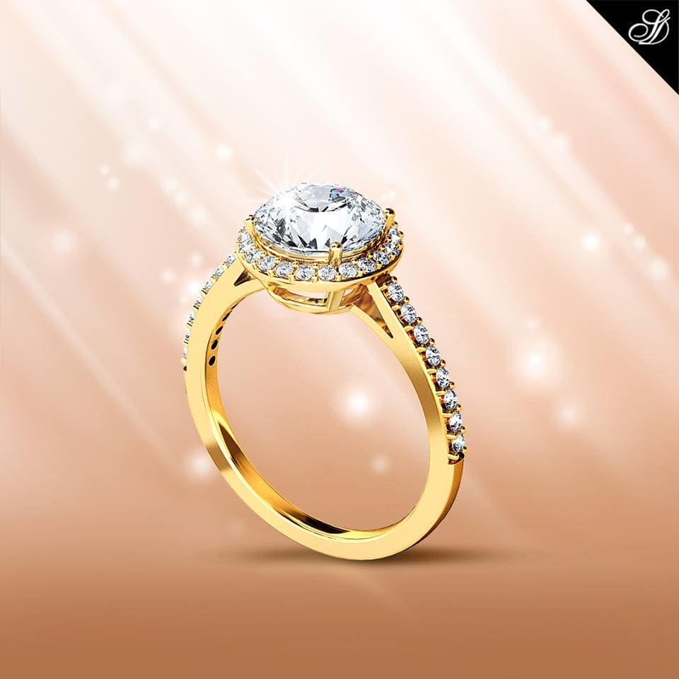 A contemporary diamond ring in a perfect blend of gold . The ring is made of a single diamond in the center and small diamonds on each side. The fine cut diamonds studded on the rings feature high luster and sheen. #diamondjewellery #diamonds #diamondring #beauty