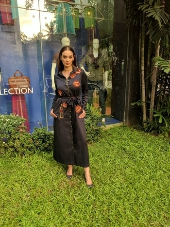 #evelynsharma keeping it casual & chic on fleek in this #shahinmannan Coca Cola shirt dress for @MissDivaOrg event  . . . #dipublicrelations  #webuildyourstory  #bollywood #celebrity #fashion