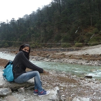 At the #Teesta river in #Sikkim freezing my ass off for this one picture, but do check out my favourite sneakers. ;)  #traveldiaries #traveljunkie #roposotalenthunt #sneakers #cold #freezingcold