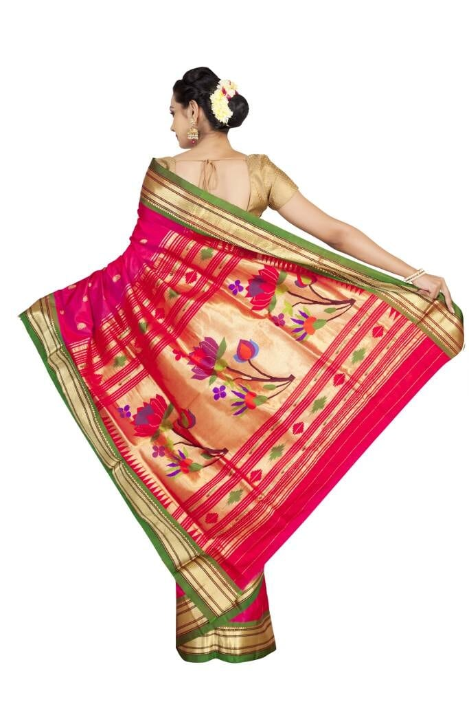 Rich pink lotus pallu paithani with contrast green border.