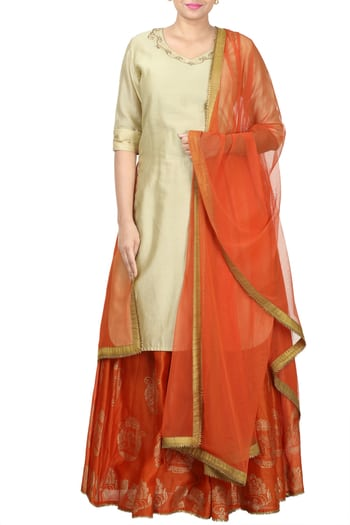 Beige Kurti with hand embriodery and orange lehanga with block print all over and orange dupatta #thehlabel