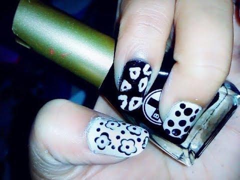 #roposotalenthunt  black and white nail art | polka, triangle and flower nail art by varsha sharma.      #nail #nailpolish #nailart #nailartdesigns #nail-addict #nailsoftheday #video #videooftheday #nailartlove #nailsofinstagram #polka #polkadots #flowers #triangle  https://www.youtube.com/channel/UCtv-abZyQ3u7fI7ykr9jlhg