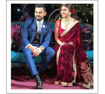 For her engagement, Anushka Sharma is wearing a Sabyasachi velvet saree. with signature Gulkand Burgundy. It was hand-embroidered using miniature pearls and the finest quality zardosi and marori. She wore a stunning uncut diamond and pearl choker with matching studs. The entire look was complemented with kohl-rimmed eyes, red roses and our now iconic micro dot bindi.
