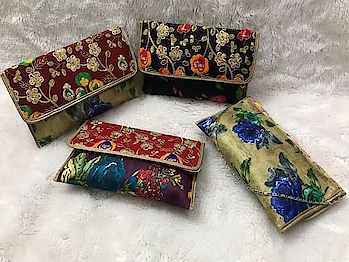 Craftstages International presents to you the exclusive embroidery fabric clutch Collection with sling (ONLY WHOLESALE). We can also Make,Customise & Import all style of Bags & Clutches with Quantity.#embroideryfabricclutch #easytocarry #indianmade #madeinindia #qualitybags #SLING #variationincolor For any Wholesale queries please call or whatsapp at +91-8882376001(ONLY WHOLESALE) or you can mail us at : craftstagesinternational@gmail.com
