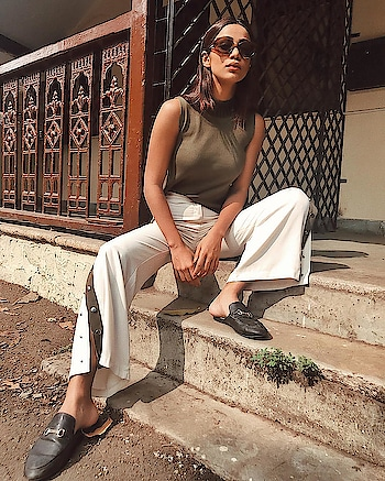 High necks and bell bottoms make the perfect combination! Credit- Santoshi Shetty