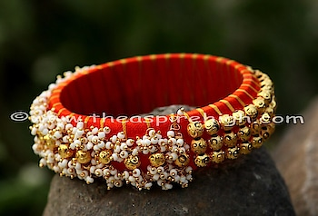 Shinning Silk Thread with golden embellishments also with pearl ones are very princely looking bangles for wearing them in any wedding function or parties along with your Indian or Indo - Western clothing. Single Bangle. Available in two sizes choose your from 2.4 or 2.6.  For more pieces and sizes please place enquiry. They can be customised in colors and sizes of your choice so can get in touch with us by leaving your query.