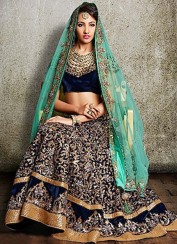 India Emporium  Featuring golden appliqué work and traditional mukesh work, this royal blue #velvet #lehenga #choli makes for a perfect Indian wedding outfit. The set includes a contrasting net choli with similar highlights. To order or enquire, Call or WhatsApp @ +91-885-135-6382 (US) +1-302-261-9333 (UK) +44-20-3290-3332 #Madetoorderoutfits #IndiaEmporium