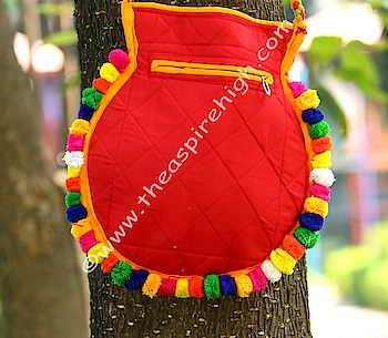This is small maroon banjara sling with fake mirror work and embroidery on it. Its small in size but quite accomodating for important stuff for going out.     Note: There could be minor difference in the thread colors and placements of pompoms of the bag as these are handmade so artisans use whatever color is available with them at the time of making. These are maroon colored bags. Shine in the bags is due to pompoms and when you take them outside. Seeing in room lights will not show their actual glory.  Exchanges pertainning to such kind of issues will not be entertained.