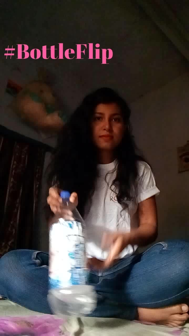 Finally after so many trial succeeded in flipping bottle straight back 🤗 #bottleflip challenge did it hmmmmm...😎 join the #Bottleflip challenge n win big 💥 prizes #roposotshirt #swag #happy @roposocontests