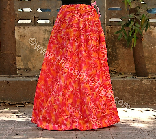 Orange Color Base Leaf Printed With Border Big Flare Full Length Skirt Rs. 1023 Our price is inclusive of GST taxes  FREE SHIPPING  The skirt in orange colour with leaf Printed and adjustable. It is the full-length skirt with slight of flare. The total ethnic looking skirt is for indo-western looks. The waist size can fit till 34 inches maximum  Dimensions:  Width on Waist -34 inches  Length - 37 inches,  Open Area - 70  inches
