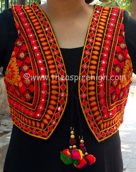 Multicolored Mirror Work Kutch Embroidered Jacket With Pompom Tassel Rs. 895 Our price is inclusive of GST taxes  FREE SHIPPING