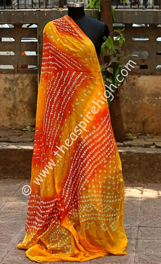 Yellow Coloured Original Bandhani Printed Semi Silk Dupatta Rs. 1598 Our price is inclusive of GST taxes  FREE SHIPPING  The dupatta has following specifications:  Size : Length - 90 inches,  Width - 41 inches  Fabric - Semi Silk  Color -  Yellow  Pattern -  Printed Dupatta