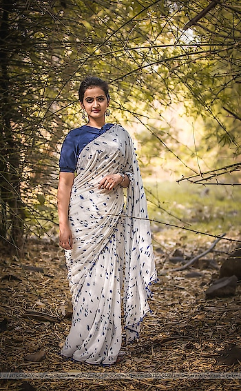 Ink Stain Saree Price: 5,999/-; US$ 90.00 ********************************************** Ink Stain Muslin-Cotton Hand-painted Saree: https://www.eastandgrace.com/products/ink-stain-silk-chiffon-saree  Featuring the Ink Stain Muslin-Cotton hand painted saree in white with blue tassels along the border. The blue ink stain pattern is painstakingly hand-painted all over the saree. Each saree is therefore unique. The matching blue blouse has peter pan collar, puff sleeves with elastic edging and adorable white, tiny ribbon bows at the back along the closure line. The saree comes with an unstitched blouse material and an unstitched matching lycra-satin petticoat fabric.  Subscribe to our newsletter on our website to get latest updates on EAST & GRACE sarees.  For order related inquiries, please reach out to us at orders@eastandgrace.com.  For all other questions/comments/concerns or just some cool banter, get in touch at care@eastandgrace.com and someone will be available to assist you!  We are humbled by the tremendous response from different parts of the world. It's what keeps us going!  More beautiful designs coming soon your way… :)  With love, EAST & GRACE www.eastandgrace.com  #eastandgrace #roposo-good #saree #blouse #queen #awesome #nature #ropo-style #like  #ilove #loveyourself  #life #photography  #ropo-love #model #ropo-beauty