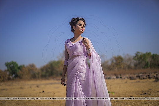NEW COLLECTION PRICE: 8,942/-; US$ 135.00 ********************************************** Please visit Lavender Breeze Saree: https://www.eastandgrace.com/collections/all/products/lavender-breeze-saree  Featuring the Lavender Breeze pure silk-organza saree in light lavender with silver, white and lavender shaded floral motifs along the saree edges. The pintuck style blouse has long, chiffon sleeves with pearl lined cuffs, and peter pan collar in lace edging. It comes with an unstitched blended raw-silk printed blouse piece and an unstitched matching lycra-satin petticoat fabric.  Subscribe to our newsletter on our website to get latest updates on EAST & GRACE sarees.  For order related inquiries, please reach out to us at orders@eastandgrace.com.  For all other questions/comments/concerns or just some cool banter, get in touch at care@eastandgrace.com and someone will be available to assist you!  We are humbled by the tremendous response from different parts of the world. It's what keeps us going!  More beautiful designs coming soon your way… :)  With love, EAST & GRACE www.eastandgrace.com  #eastandgrace #saree #blouse #sari #desi #lehenga #ribbonembroidery #handembroidery #onlineshopping #indianfashion #nature #fashion #fashionista #designer #photography #fashionphotography #naturephotography #purple #lavender #pureorganza #silkorganza #organza #mylifemychoice #pop #trends #followmeonroposo #nature #loveyourself #roposolove #best #fashion #happyvibes #haha #model