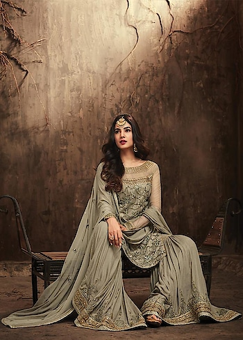 The stunning #SonalChauhan is keeping it trendy this Festive Season. Grab this Stunning #Greenishgrey Party Wear Suit with #Sharara @ https://goo.gl/eKGHfL  #celebritystyle #indianfashion #bollywood #bollywoodactress #eidsale #bakraeidsale #bakraeid #jashneeid #designerwear #indiandesigner #bollywoodfashion #ShopNow #Surat #Mumbai #India #USA #unitedstates #Canada #Australia #Dubai #UAE #Mauritius #London #Uk